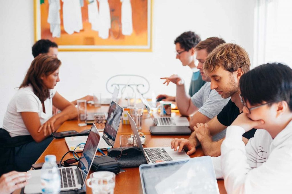 Group of people sitting at a meeting table